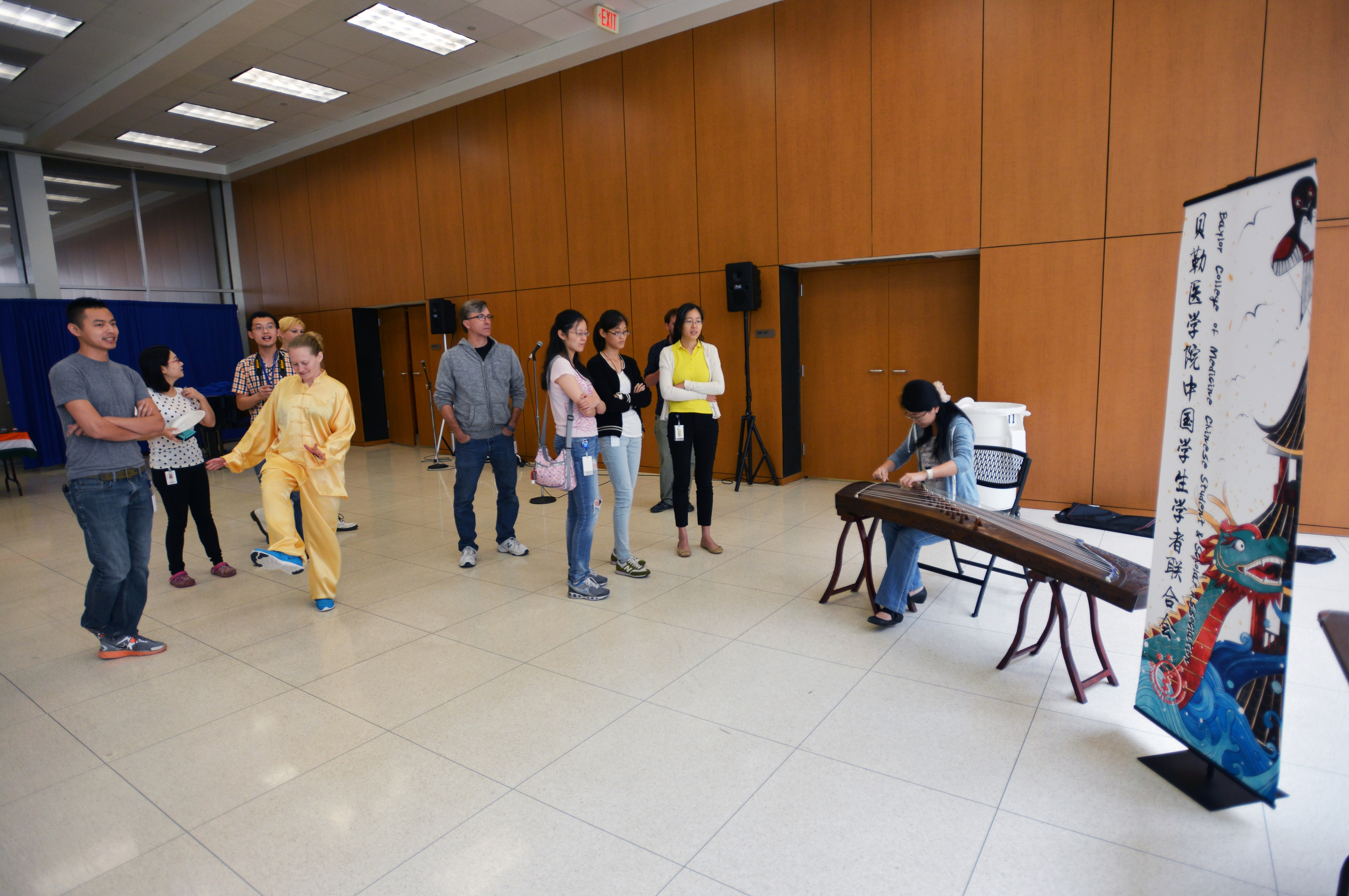 Students playing music for attendees.
