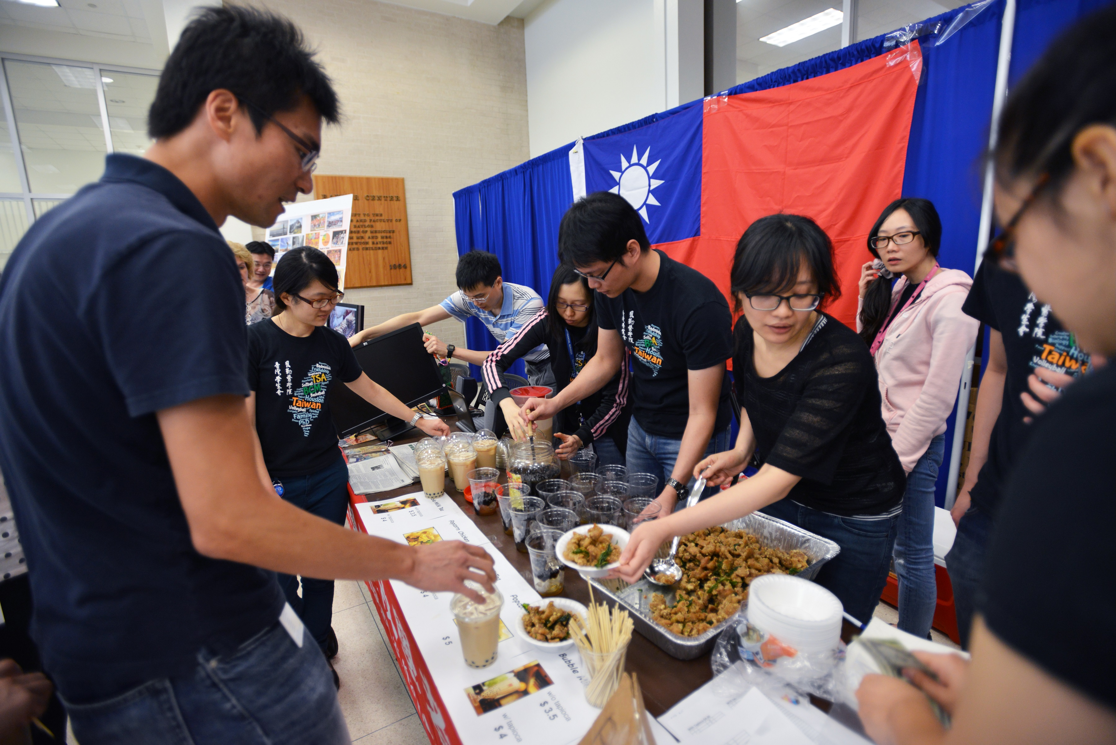 Students and trainees showcasing food from around the world.