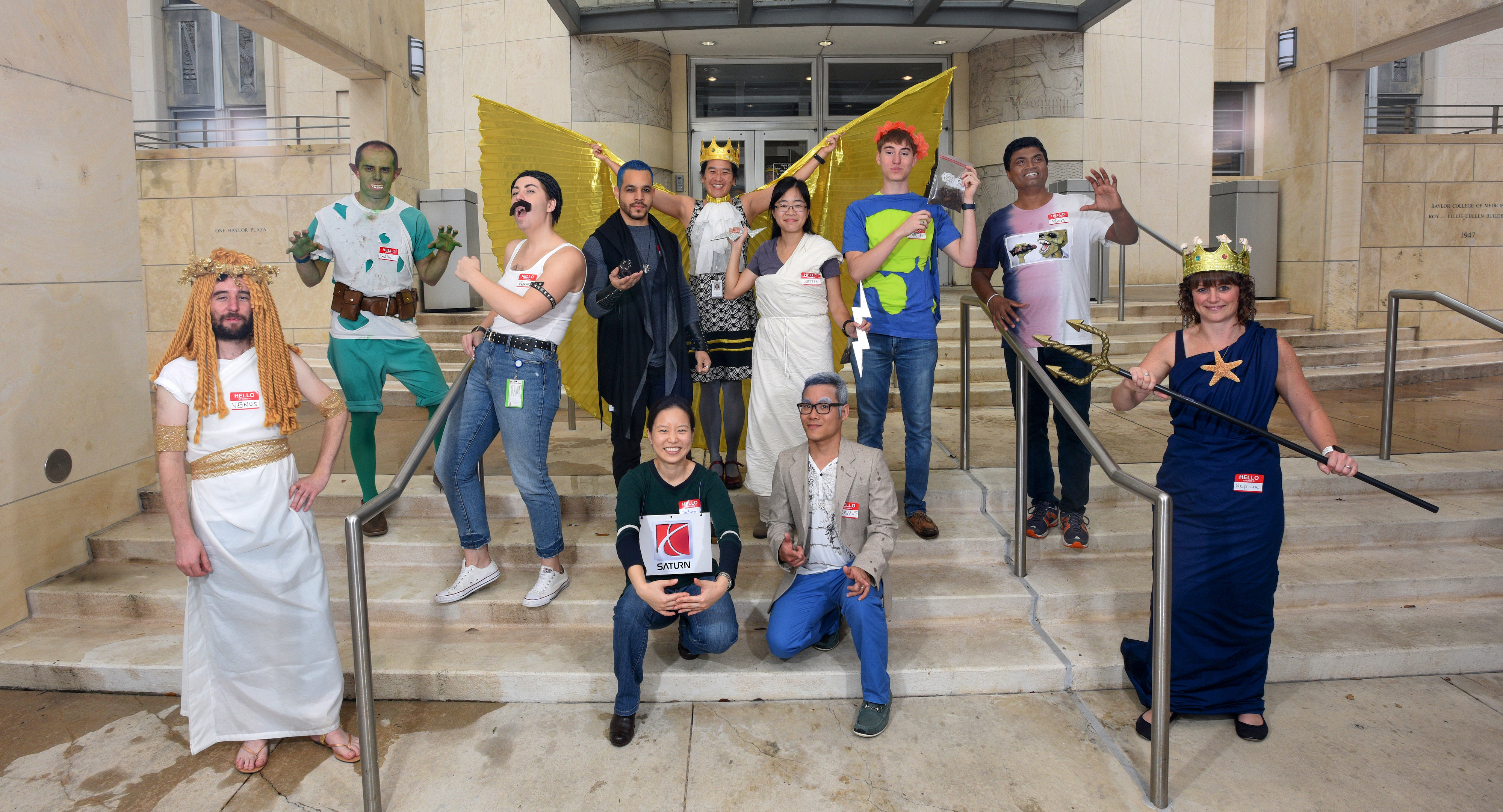 Members of the King lab dress as an abstract representation of the Solar System