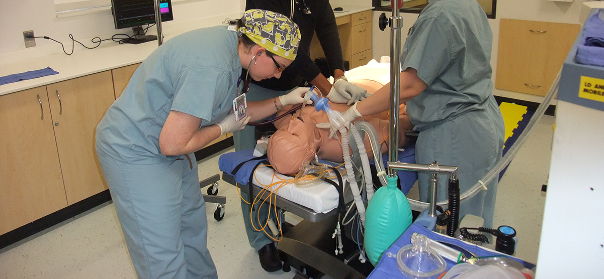 Anesthesia residents running a scenario in the simulation lab
