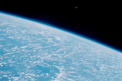 Photo of moon rise over the Earth taken from the Space Shuttle Discovery