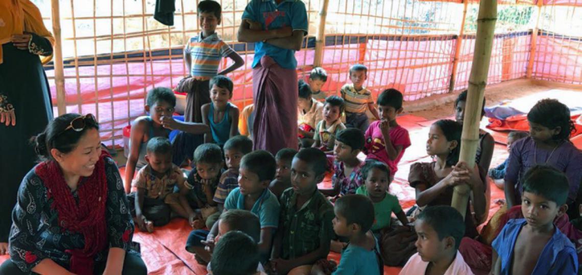 Dr. Banu with refugee children