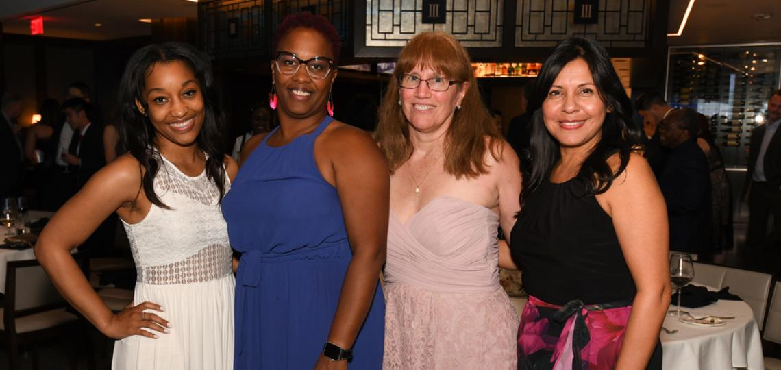 OBGYN Education Coordinators pose together at an event.
