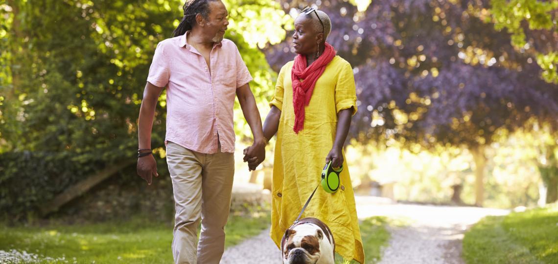Man and Woman Walking Dog