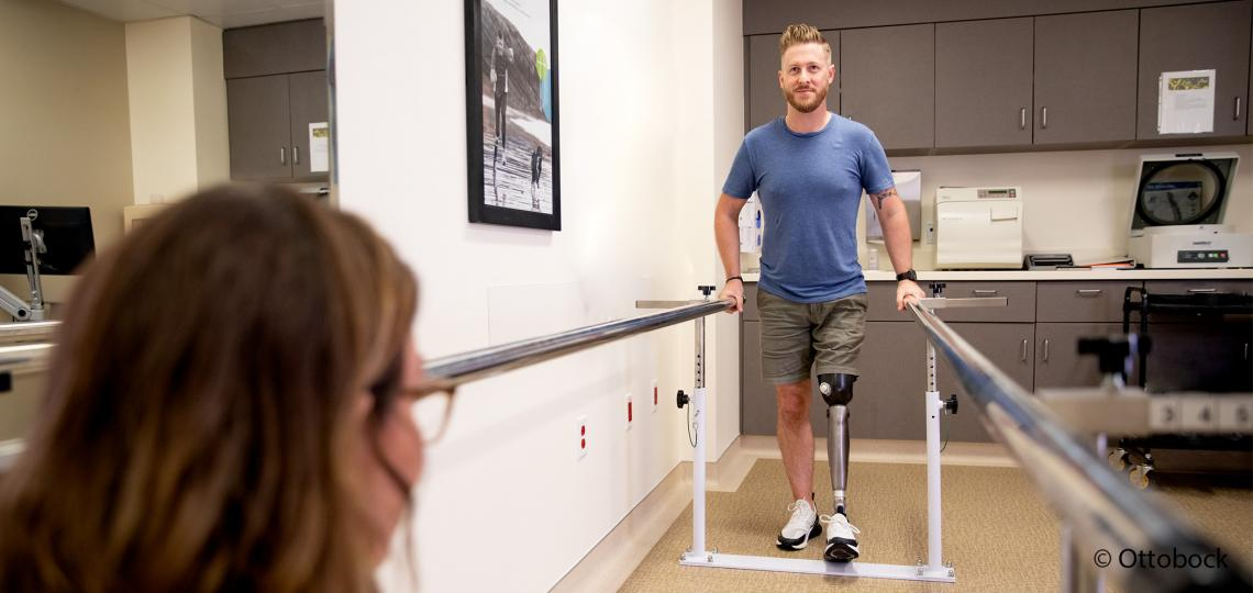 Man with prosthetic leg in physical therapy