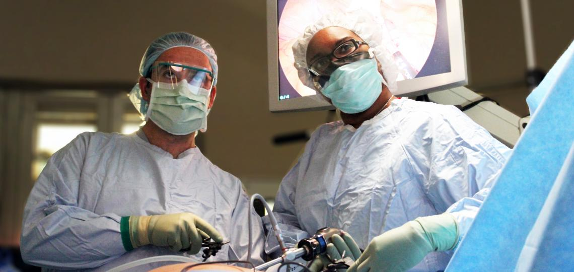 Two surgeons performing laparoscopic surgery in an operating room