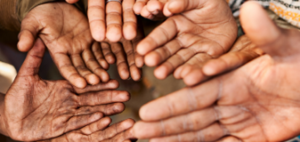 Group of  hands outreached.