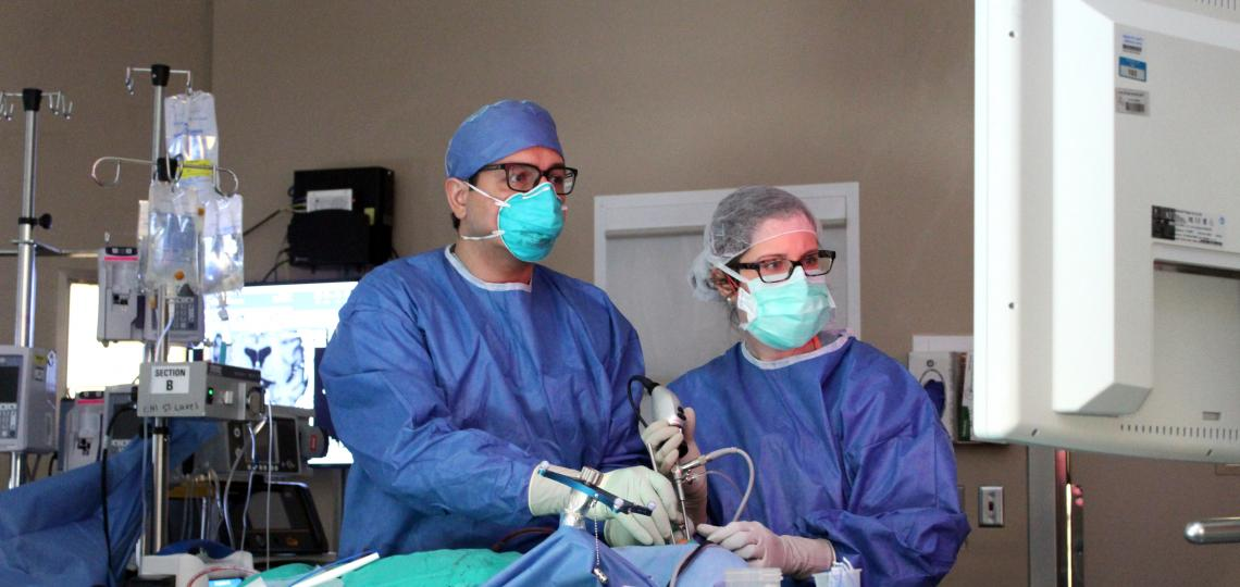 Two doctors performing a surgical procedure.