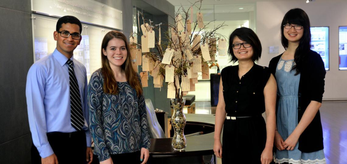 From left: Lakshay Jain, Malia Gresham, Rui Zheng and Susan Xie standing next the the Willed Body Memorial Tree.