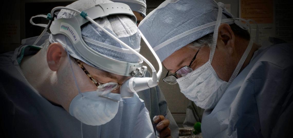 Drs. Bryan Burt and David Sugarbaker in the OR.