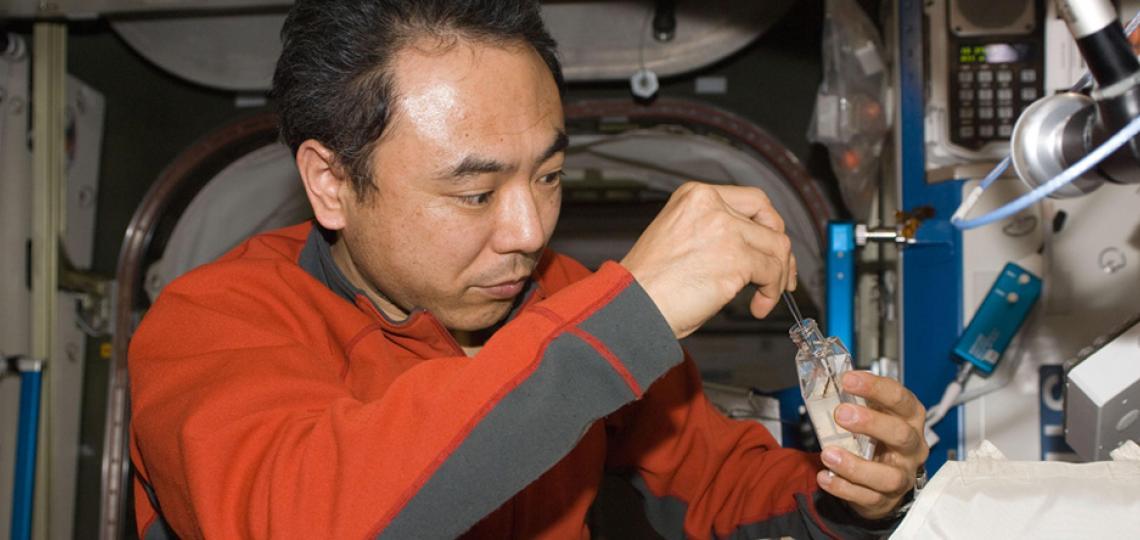 JAXA astronaut Satoshi Furukasa working on Plants in Space.