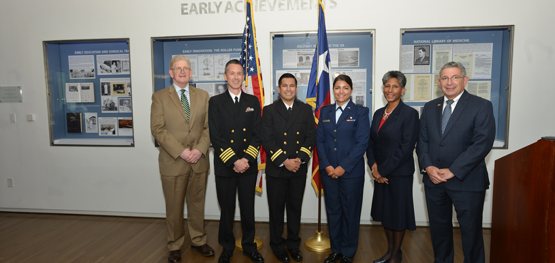 Dr. Eric Schoomaker, Dr. Timothy Porea, Bryant Nieto, Amanda Delgado, Provost Dr. Alicia Monroe and President Dr. Paul Klotman pose for a photo following the commissioning.