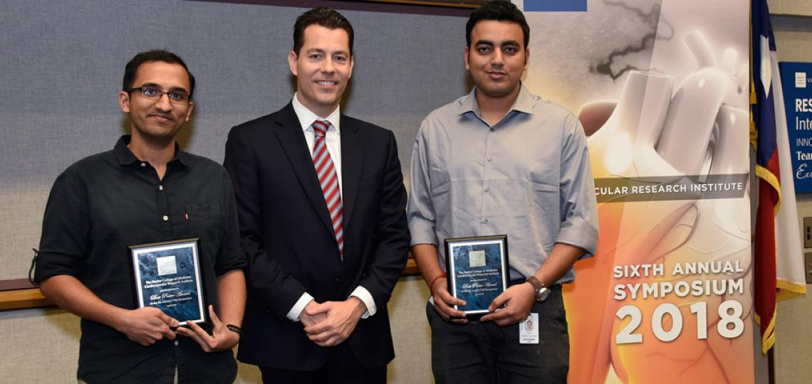 Winners of the Best Poster from the CVRI 2018 Symposium pose for a photo. From left: Ashish Rao, CVRI Director Xander Wehrens and Satadru Lahiri. Not pictured: Khurrum Khan and Parag Jain