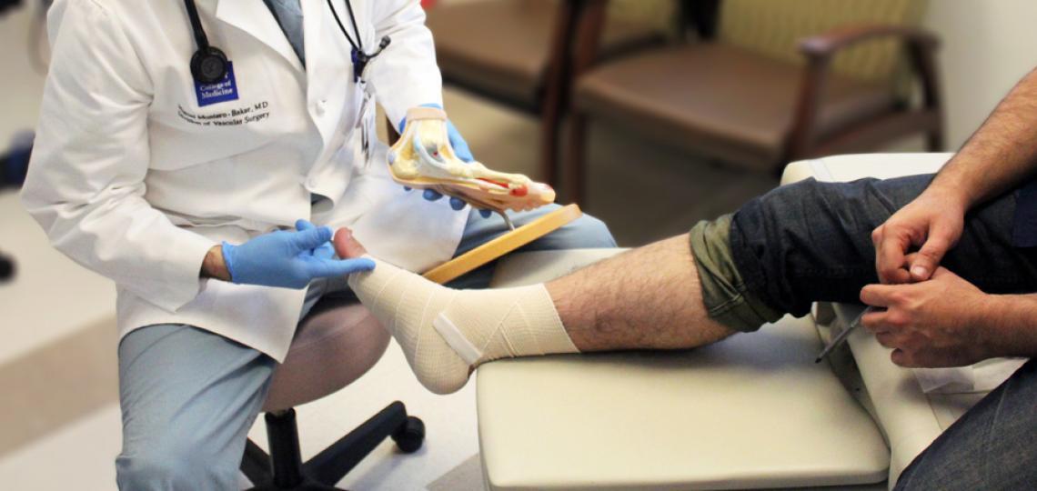 Dr. Miguel Montero-Baker assesses a patient's leg.