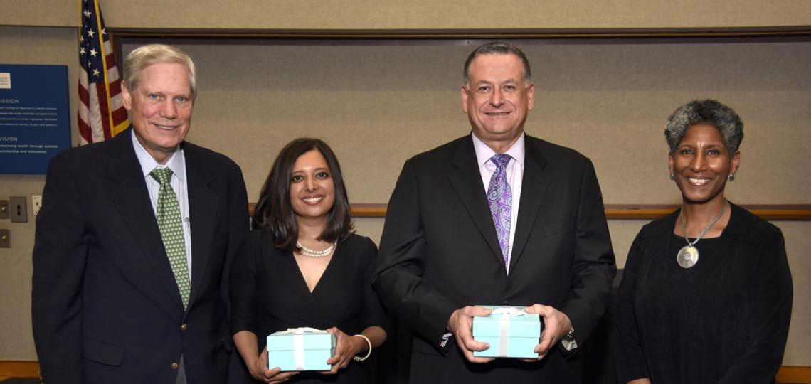 Corbin J. Robertson, Jr., and Provost Alicia Monroe  flank Robertson Presidential Award winners Dr. Geeta Singhal Das and Dr. Jim Walker.