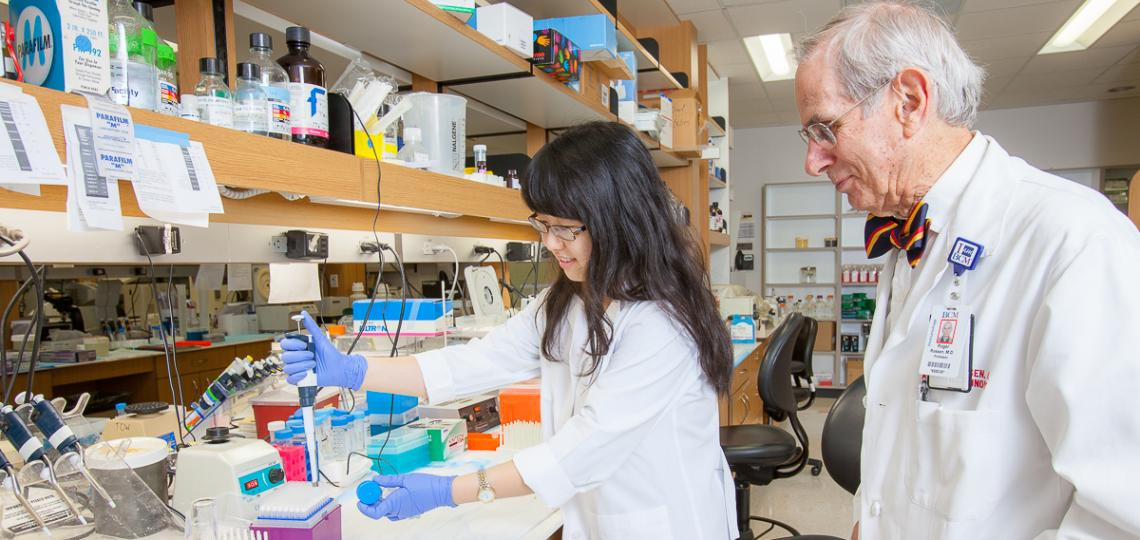 Dr. Roger Rossen in the lab with student