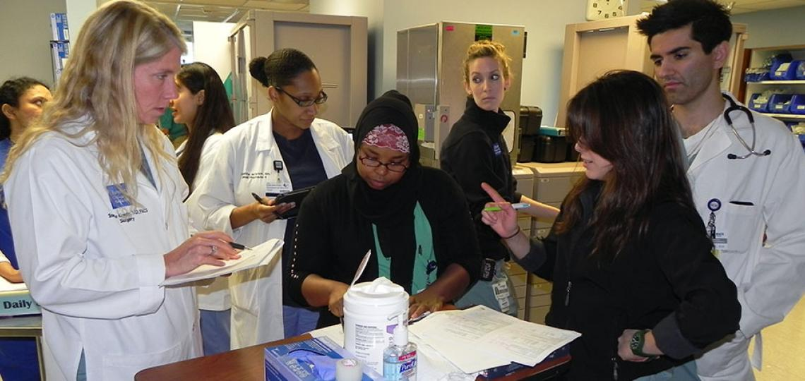 Dr. Stephanie Gordy engages surgical critical care residents during rounds.