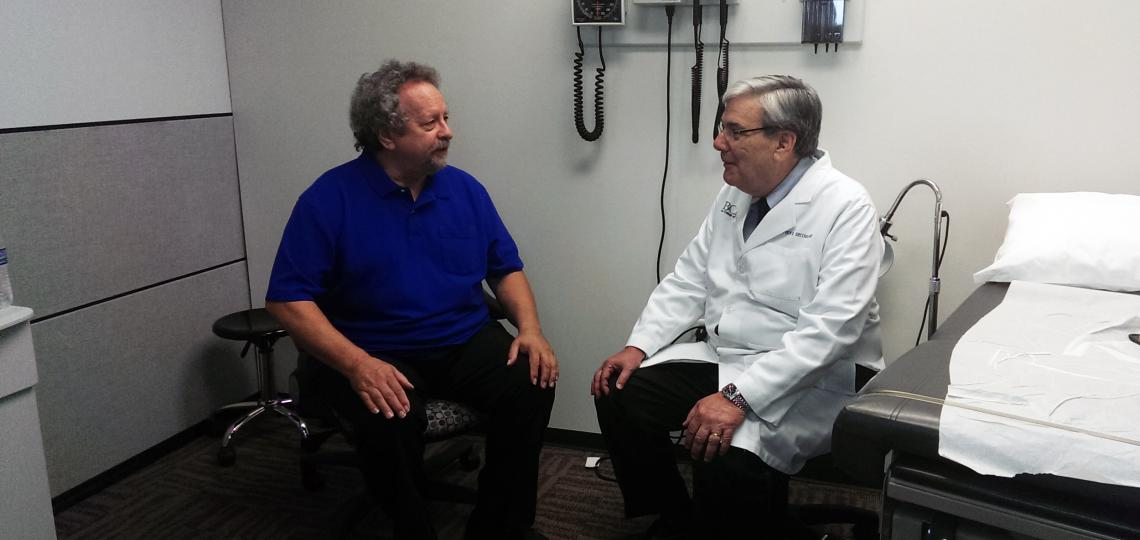 Dr. Greenberg talking with a simulated patient.
