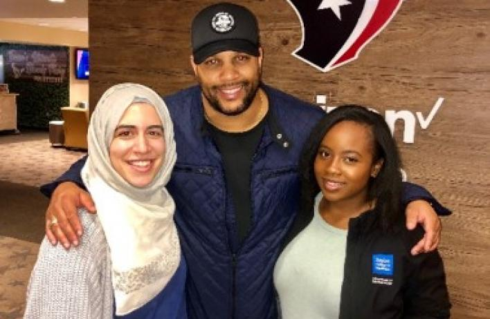 Dermatology residents with a player from the Texans