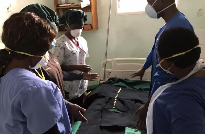 Global Women's Health Track residents attending a patient in the Malawi clinic.
