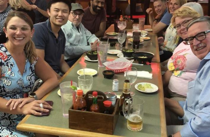 Residents and faculty enjoy dinner together.