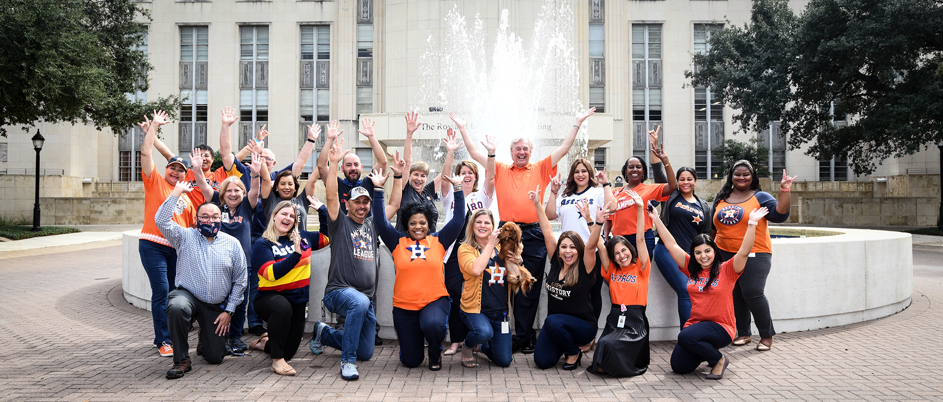 Members of the Baylor community celebrating the Houston Astros outside the Cullen buiding.