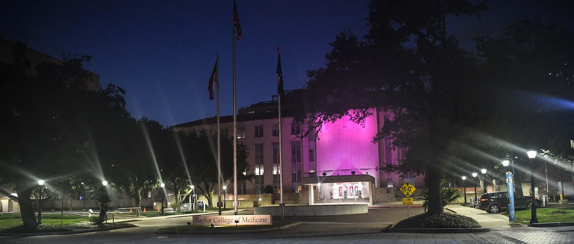 Baylor College of Medicine's Cullen building illuminated pink in recognition of Breast Cancer Awareness month.