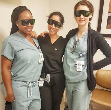 Dermatology residents in scrubs