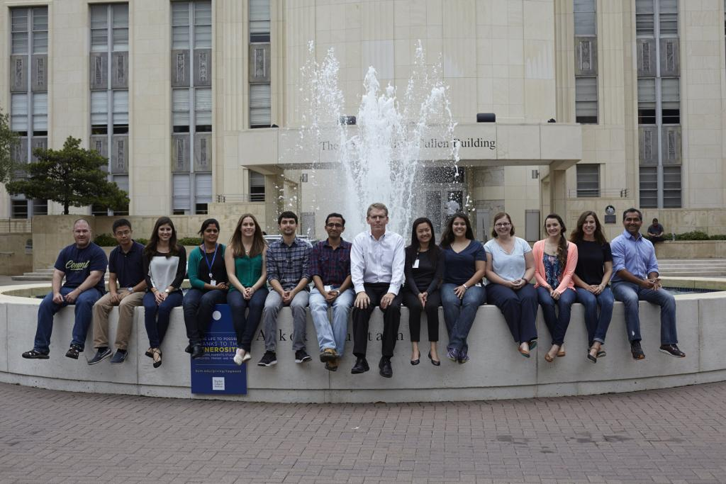 Members of the Cooper Lab in front of the Alkek Fountain at Baylor College of Medicine.