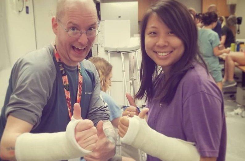 Two Physician Assistant students in casts.