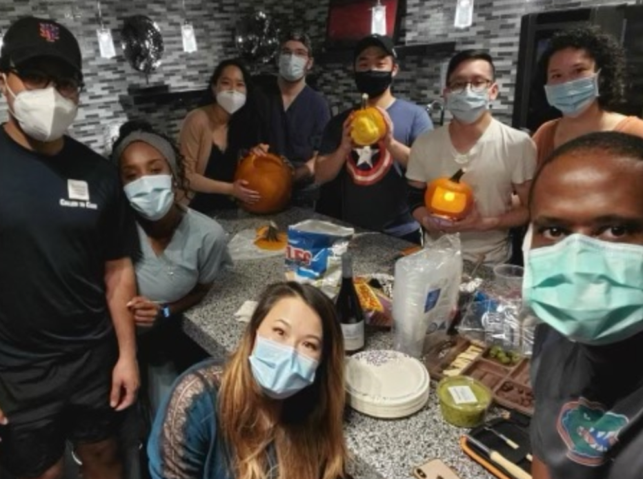 Anesthesia residents carve Halloween pumpkins at a department wellness event.