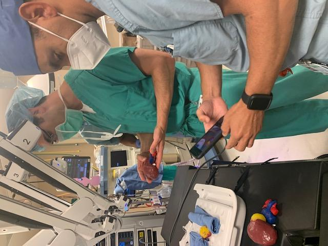 Drs. Wes Mayer and Rair Valero Carrion admire their work while practicing robotic partial nephrectomy using a new 3D modelling technology.