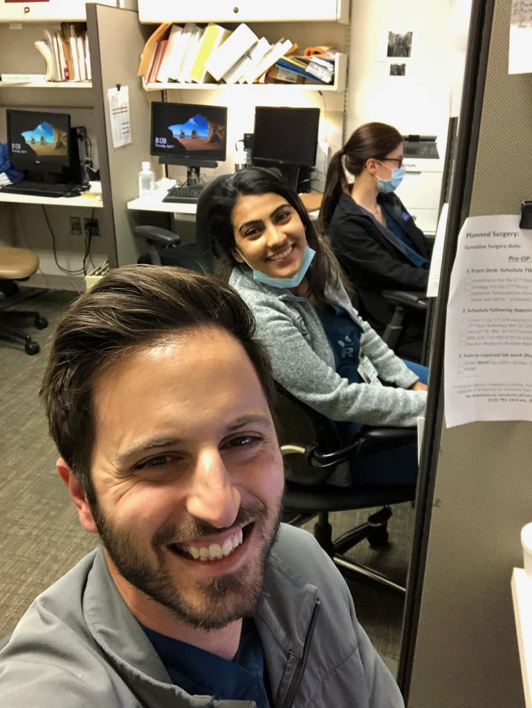 Residents, Drs. Anaissie and Johny, are all smiles during a busy clinic day at the VA.