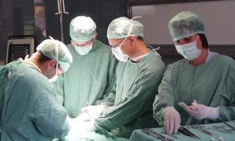 Doctors performing a surgery.