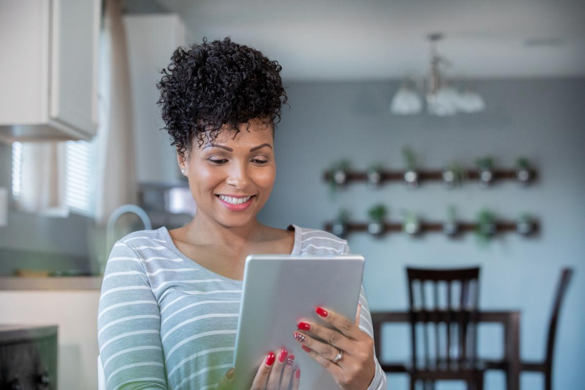 Women on tablet to call doctor