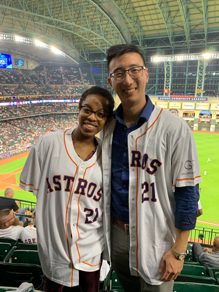PACT Fellows Nurah Lawal and Selby Chu cheering on the Houston Astros