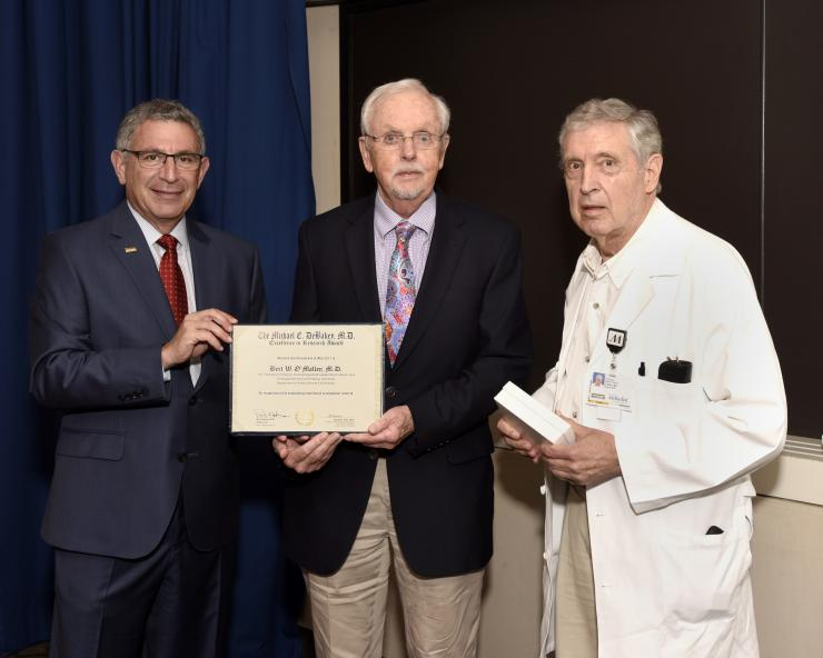 Dr. Bert W. O'Malley with Drs. Paul Klotman and George Noon