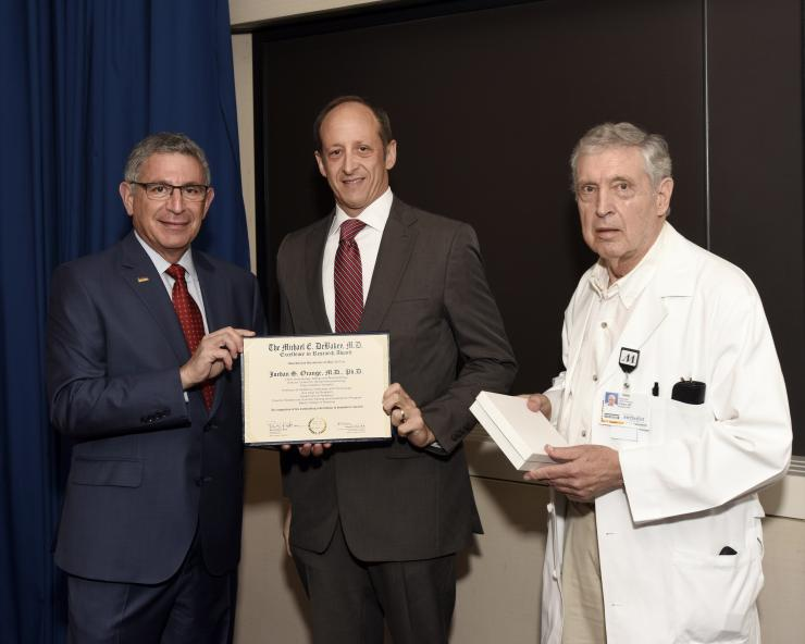 Dr. Jordan S. Orange with Drs. Paul Klotman and George Noon
