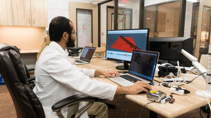 Muhammad Shamim, M.D. Ph.D. student, using mapping software in the Aiden lab.