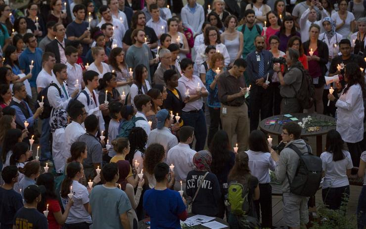 Gathering of students, faculty and staff from across the TMC gathering for candlelight vigil.
