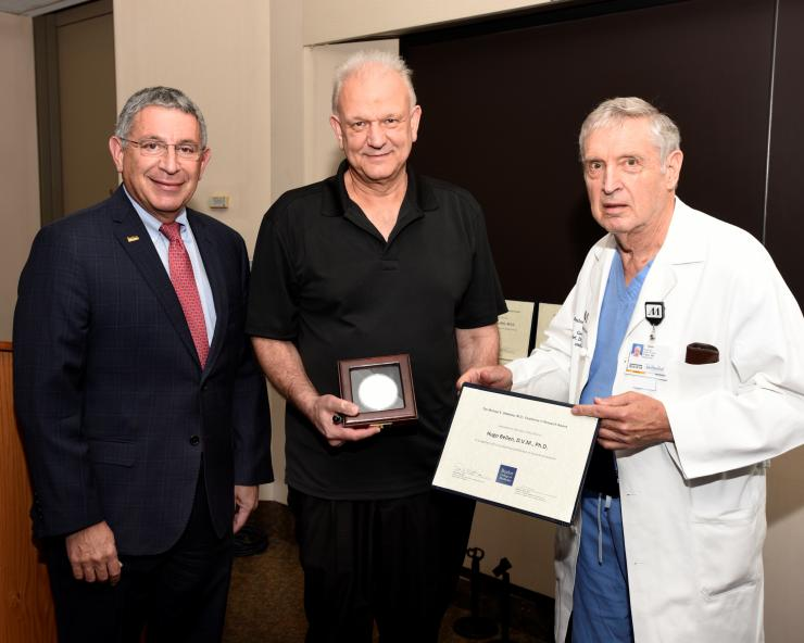 From left to right: Dr. Paul Klotman, Dr. Hugo Bellen and Dr. George Noon