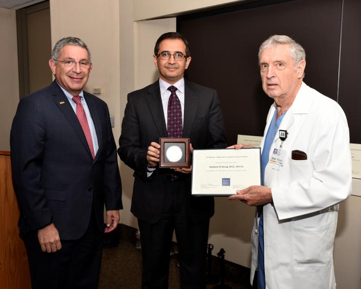 From left to right: Dr. Paul Klotman, Hashem El-Serag and Dr. George Noon