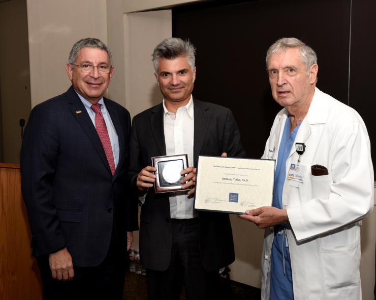 From left to right: Dr. Paul Klotman, Dr. Andreas Tolias and Dr. George Noon