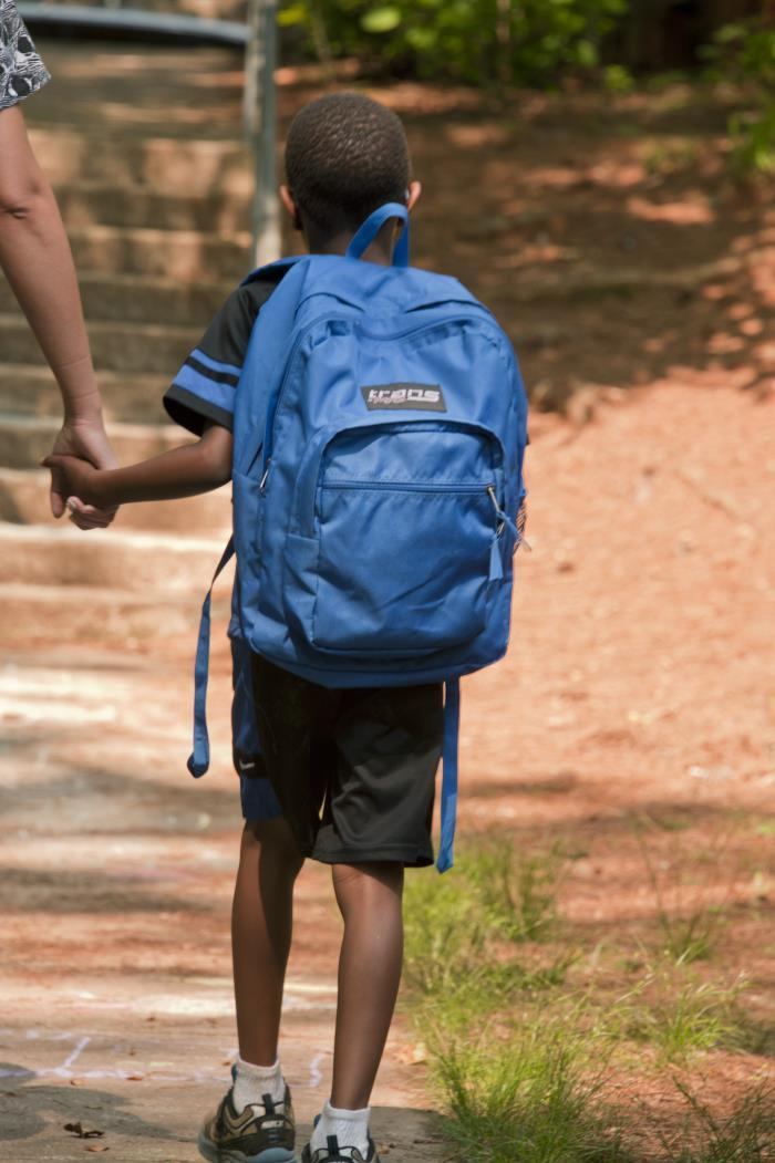 African American boy walking to school