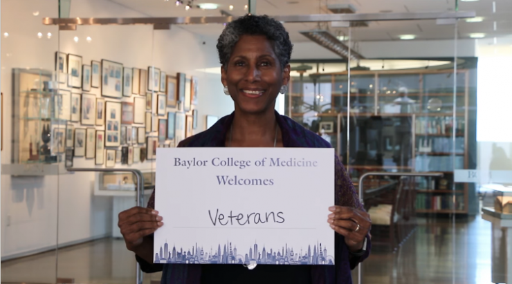 """Dr. Alicia D.H. Monroe, senior vice president and provost, holding a """"Baylor College of Medicine Welcomes Veterans"""" sign for Diversity and Inclusion Week video"""