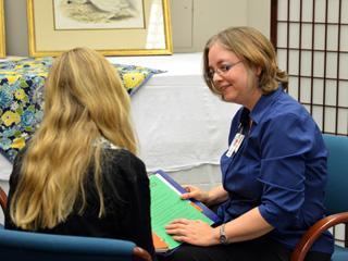 Melody Fregia, M.A., LPC, counsels a patient.