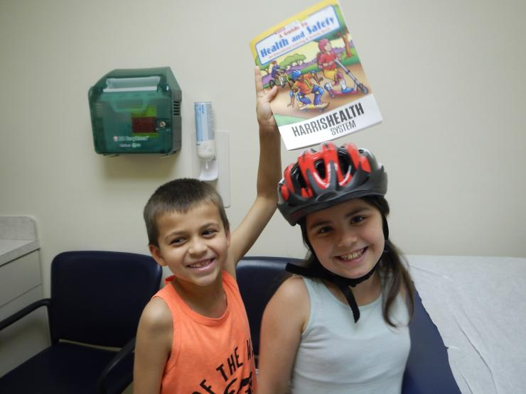 Physicians and residents gave away bicycle helmets, discusses safety during the summer months.