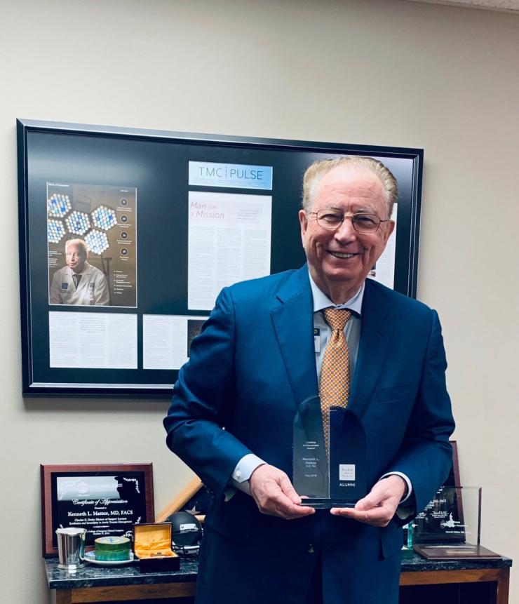 Kenneth L. Mattox, M.D. '64, with his Lifetime Achievement Award.