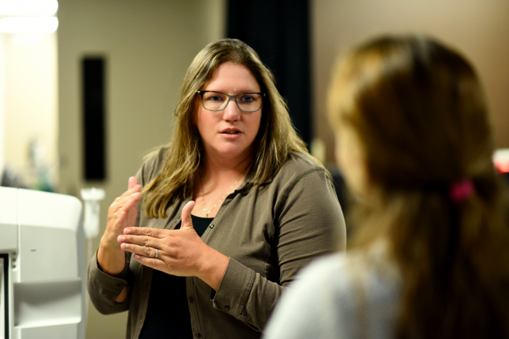 Dr. Mary Dickinson talks with a colleague in her research lab.