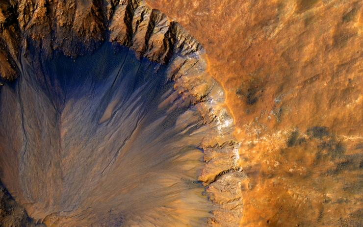 Impact crater in the Sirenum Fossae region of Mars on March 30, 2015.